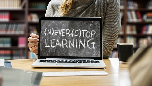 laptop with never stop learning on screen
