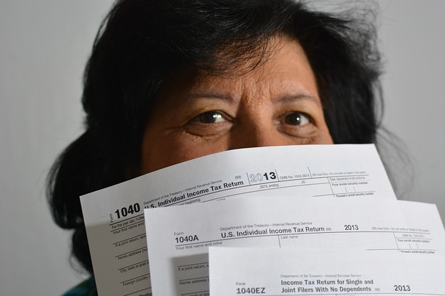 I woman holding tax papers